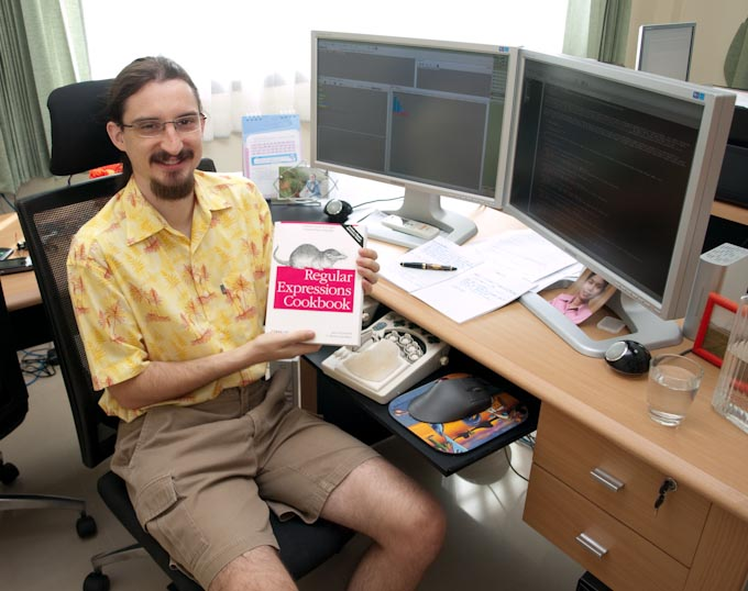 Jan Goyvaerts holding his author copy of Regular Expressions Cookbook